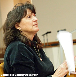 Photo of Marisa Bussey testifying. She was worried about the RV Park expanding.