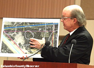 Attorney Terrell Arline points to the site plan.