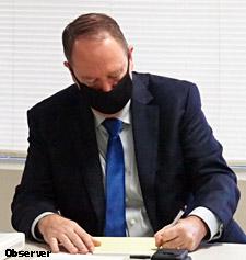 City Manager Joe Helfenberger takes notes.