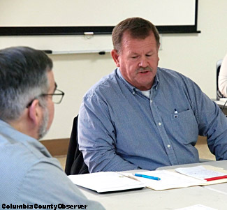 EDAB Chairman Tim Murphy (right) discusses City-County utility issues and Interim County Manager David Kraus looks on.