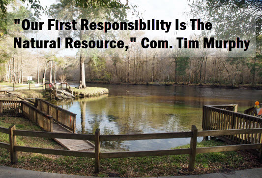 "Photo of Rum Island Spring with copy that reads, ""Our first responsibility is the natural resourse,"" Com. Tim Murphy"