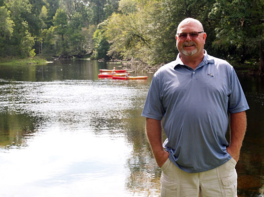 Commissioner Rocky Ford on the bank of the Santa Fe River and Rum Island Park